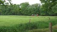 Farmer on tractor spreading organic manure in small scaled landscape Stock Footage