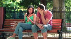 Couple fighting, arguing on bench in park HD Stock Footage