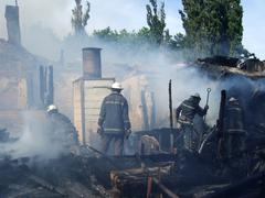 Firefighters extinguish a fire in an apartment house Stock Photos