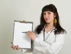 female doctor holding blank billboard - stock photo