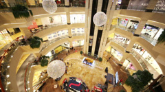 Visitors move on elevator near shops of AFIMALL CITY Stock Footage