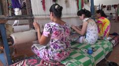 Girls are making carpets inside Uzbekistan factory Stock Footage