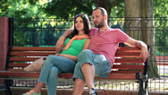 Stock Video Footage of Happy couple relaxing on bench in park HD