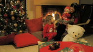 Stock Video Footage of A mother reads Christmas stories to their children