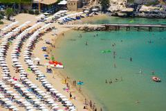 view from above of the main beach in lindos, rhodes, one of the dodecanese is - stock photo