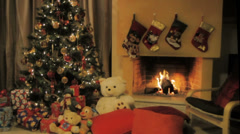 A burning fireplace with Christmas decoration at Christmas Eve 1 Stock Footage