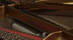 Detail of piano chords move during a performance Stock Footage
