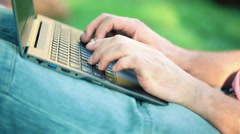 Closeup of man hands typing on modern laptop HD - stock footage