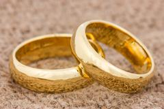 wedding rings on the burlap - stock photo