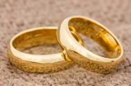 Stock Photo of wedding rings on the burlap