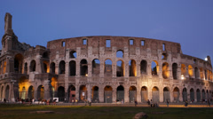 Illuminated Colosseum by dusk in Rome Italy European Tourists Visiting Landmark Stock Footage