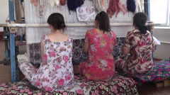 Young women are making rugs in Uzbekistan Stock Footage