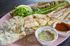 prepared salted grill snakehead fish with spices in thailand - stock photo