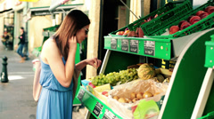 Woman on shopping looking at fruits, vegetables in shop HD Stock Footage