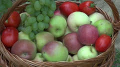 Hands putting apples and white grapes in a basket, fruits, farm, orchard,harvest Stock Footage