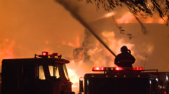 FIRE AND FIREFIGHTER FIREMEN FIRETRUCK FLAMING STORM INFERNO Stock Footage