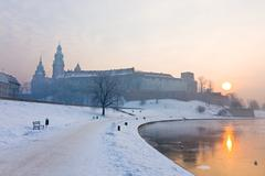 Historic royal wawel castle in cracow, poland, with frozen vistula river in w Stock Photos