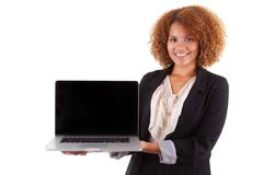 african american business woman holding a laptop - black people - stock photo