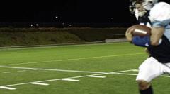 Running Back Runs the Ball Stock Footage