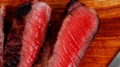 Roast beef steak on wood Stock Footage