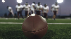Football Players at the Line of Scrimmage Stock Footage