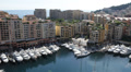 Aerial View Skyline, Iconic Fontvieille Harbor, Yachts Rich tax haven sunny day HD Footage