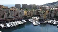 Aerial View Skyline, Iconic Fontvieille Harbor, Yachts Rich tax haven sunny day Stock Footage