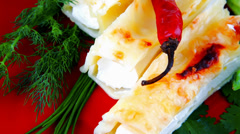 Cheese cannelloni served with pepper and tomato Stock Footage