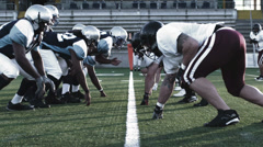 Football Players at the Line of Scrimmage - stock footage