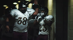Football Players Walk Through Tunnel - stock footage