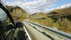 Driving a car on the serpentine mountain in the Altai (POV) Stock Footage