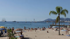 Establishing Shot French Riviera Cannes Sandy Beach People Sunbathing Swim Day Stock Footage