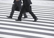 Stock Photo of Businessmen walking on crosswalk