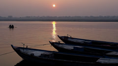 Boats on the Ganges at Sunrise in Varanasi, India - stock footage