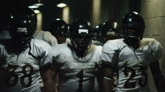 Football Players Walk Through Tunnel Stock Footage