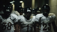 Stock Video Footage of Football Players Walk Through Tunnel
