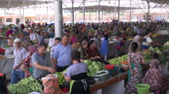 People buy groceries at Samarkand bazaar Stock Footage