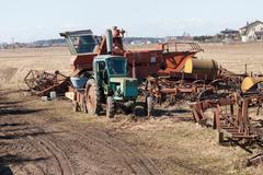 old agriculture machines - stock photo