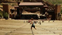 Day High angle wide shot Red Rocks amphitheatre Denver, Colorado with joggers  Stock Footage