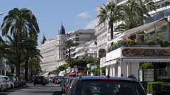Carlton Hotel Intercontinental Car Traffic French Riviera Cannes Cote d'Azur Stock Footage