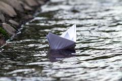 abstract view of paper boat - stock photo