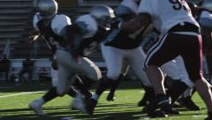 Running Back Runs the Ball Stock Footage