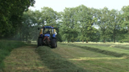 Tractor collects hay from field with a bale slicer Stock Footage
