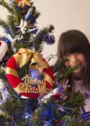 A Christmas tree and a girl - stock photo