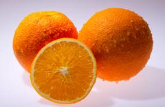 Navel seedless orange isolated on white Stock Photos