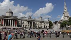Trafalgar Square People Pedestrians Tourists Visiting Walking Passing, London UK Stock Footage