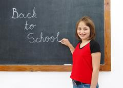 elementary writing back to school on chalkboard - stock photo