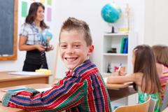 cheerful young boy in school - stock photo