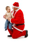 Santa claus and little boy together Stock Photos