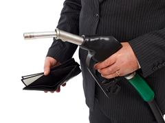gas nozzle and empty wallet - stock photo